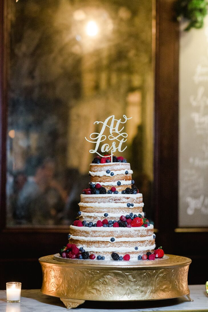 Tiered Naked Cake with Fresh Berries and a Cake Topper