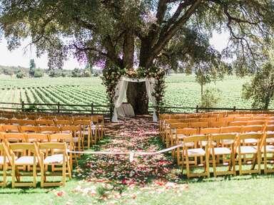 Outdoor wedding ceremony at vineyard