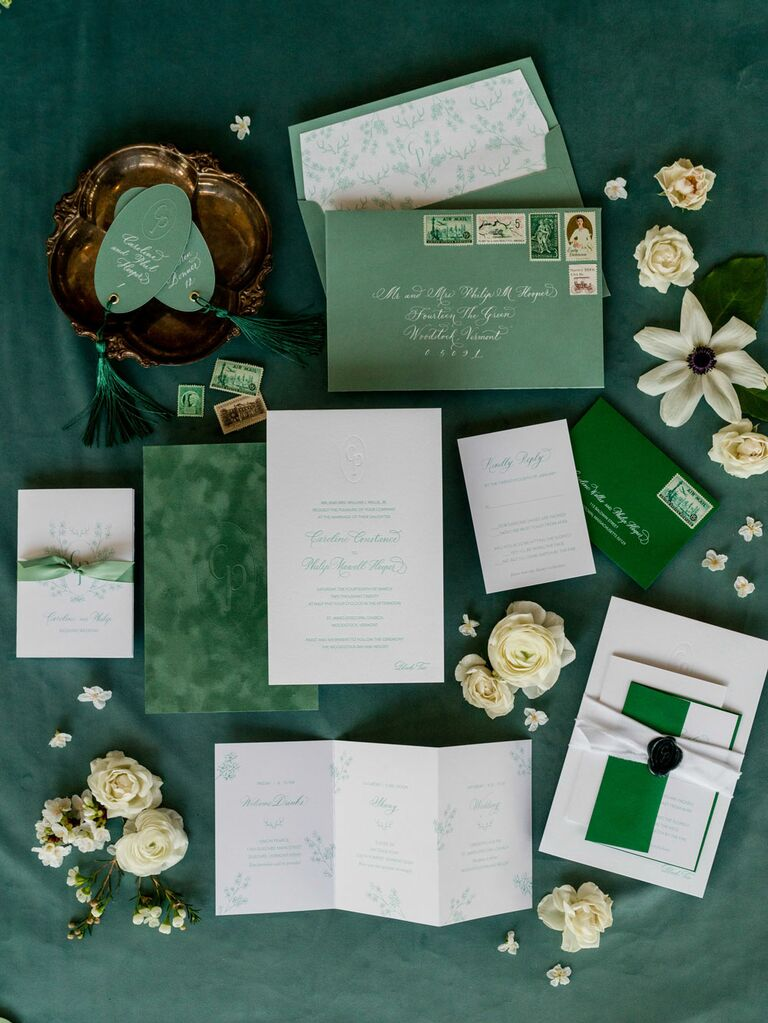 Green and white wedding invitation suite flat lay