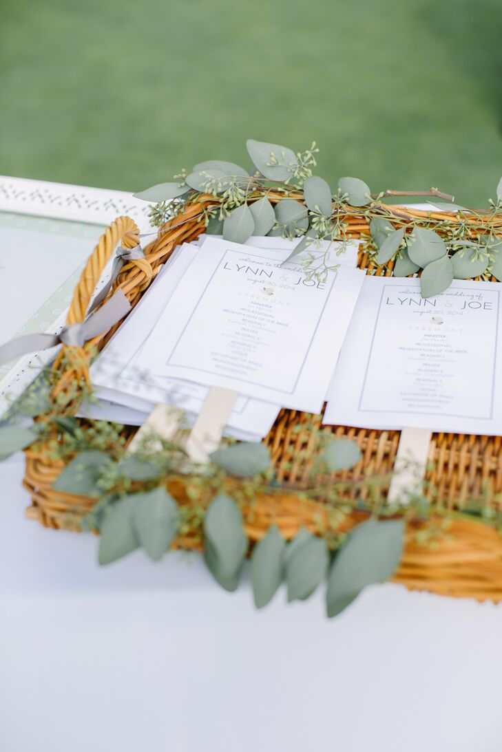 With a wedding date set for the end of August, Lynn and Joe wanted to make sure guests were comfortable in the event of high temps. For their programs, the couple chose a fan design, which would help keep guests cool during the outdoor ceremony.