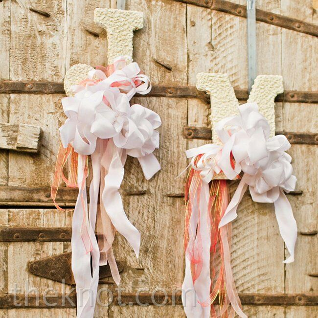To give consistency to the weekend's events, Megan and Jeff introduced the color scheme at the rehearsal dinner: They hung letters of their monogram and softened them up with sweet pink and white ribbons.