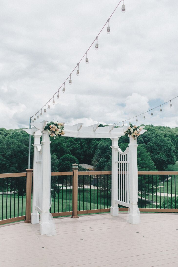 The couple exchanged vows in front of a gorgeous garden arch on the patio overlooking the gorgeous grounds at A View in Fontenelle Hills in Bellevue, Nebraska.