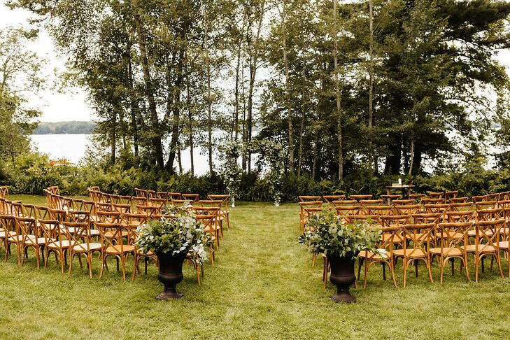 Natural Waterfront Ceremony Site with Cross-back Chairs and Aisle Decorations