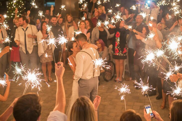"""""""One of my very favorite parts of the reception was our first dance,"""" Andrea says. The guests held sparklers around the couple as they danced together. """"It was so romantic, and a great way to include our guests in the dance,"""" Andrea says."""