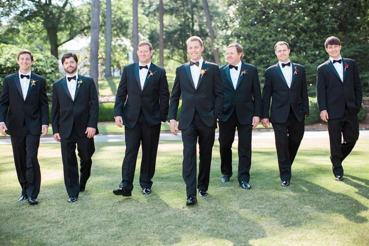 """For the groomsmen, we kept things classic with black, slim-fit tuxes and black bow ties. ""The groomsmen also had Alabama turkey feathers incorporated into their boutonnieres,"" Keeley says."