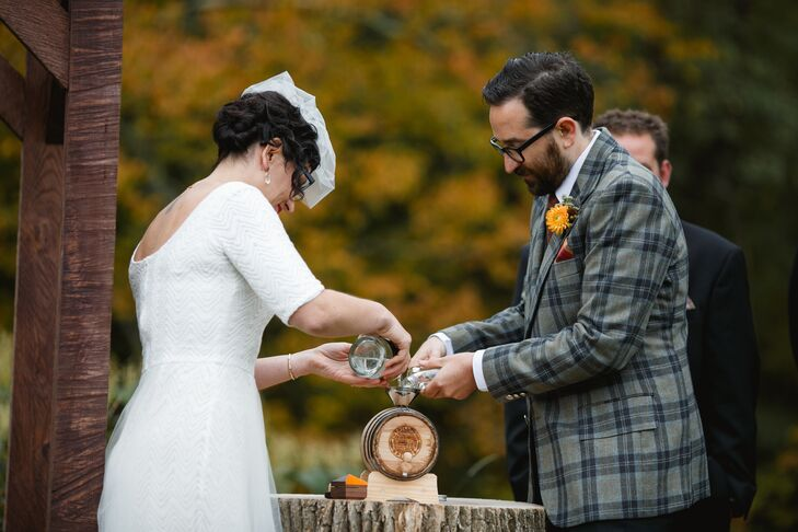The couple had a whiskey ceremony instead of lighting a unity candle. They poured unaged corn whiskey (some from Brooklyn and some from upstate New York) into a two-liter barrel and will drink it on their first anniversary.