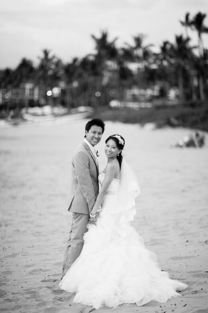 Emily and Jason celebrated a romantic marriage ceremony and reception at the Four Seasons Maui in Hawaii. The theme of the occasion was sophisticated romance. Soft purples and pinks blended with cascading crystal beads and silver accents for an elegant, tropical affair.