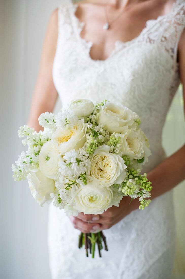 Lush garden roses and ranunculus gave Emily's bridal bouquet a classic, romantic feel, and clusters of bright white lilacs captured the vitality of spring and added a light fragrance to the arrangement.