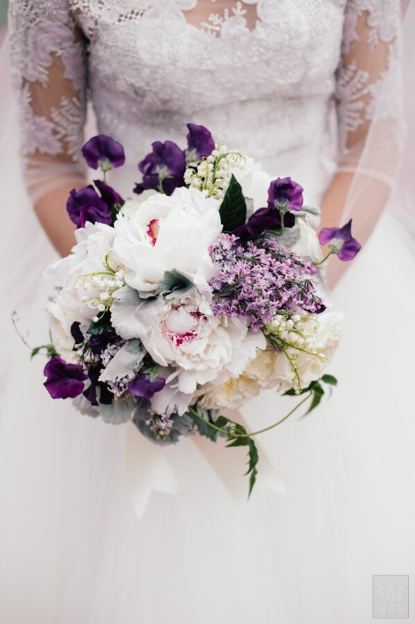 McKenzie carried a bouquet of white peonies with pink centers, deep purple violets, dusty miller and lily of the valley on her spring wedding day.