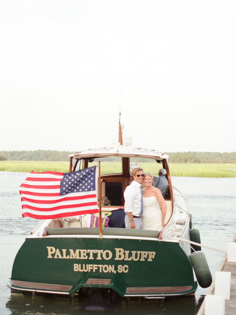 Bride and groom exiting on boat