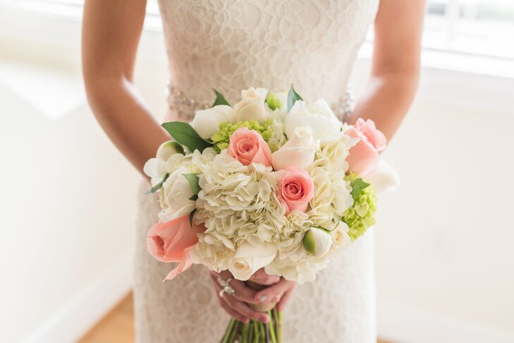 To celebrate the spring season, Jordan and Austin selected seasonal blooms in light, cheerful colors. For her bouquet, Jordan opted to carry a fresh mix of classic white and pale pink roses, ivory and green hydrangeas and white peonies down the aisle, the elegant bunch complementing the timeless, sophisticated feel of her dress.