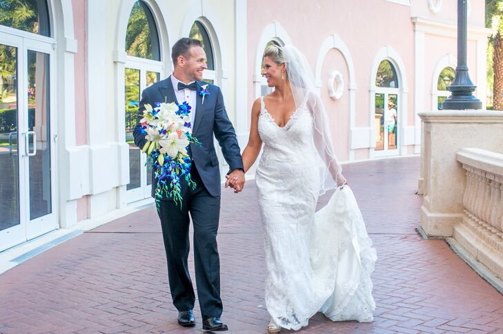Ashley Wallace (33) and Phil Schneider (34) knew they wanted a beach-chic wedding and went all-out with a matching royal blue and white color scheme.