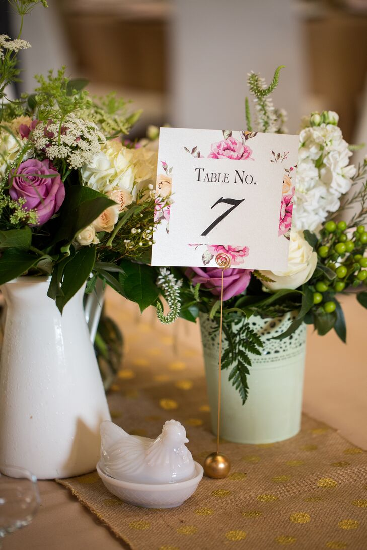 The table numbers echoed the invitations' look and feel with the pastel floral design. The numbers were a little softer, though, with the classic black-on-white type and pink and yellow colors. All the paper goods for the day were gorgeously created by Haley's friend Joanne Stein.