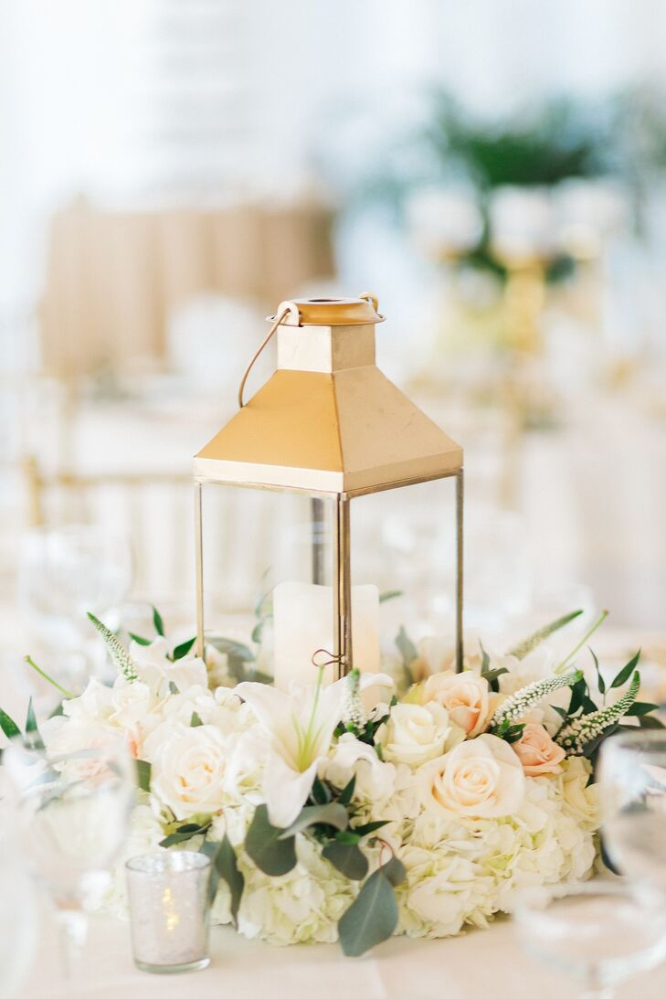 For Kay and Ben's reception at Key Colony Inn in Key Colony Beach, Florida, tables were topped with gold lanterns, votive candles and floral arrangements.