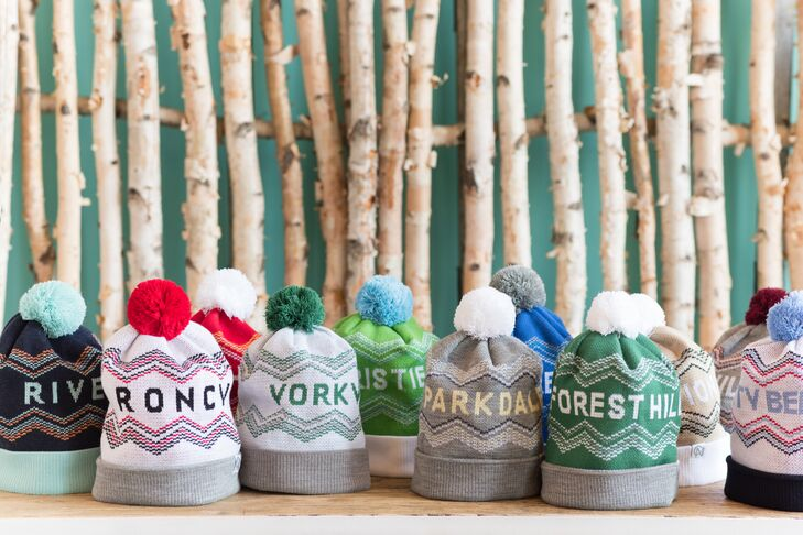 """Guests left with colorful knit hats, each stitched with names of different, popular ski destinations. Each pom-pom hat held a """"hangover kit,"""" including Advil and a personalized water bottles reading: """"You'll REALLY thank us for this in the morning."""""""