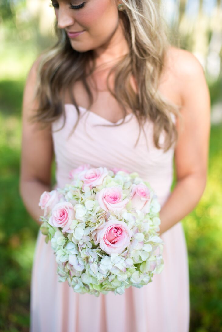 The bridesmaids carried green hydrangeas and blush roses in their bouquets.