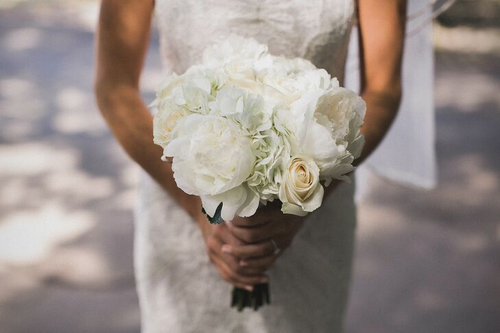 Nicole walked down the aisle carrying a white bouquet with peonies, roses and hydrangeas.