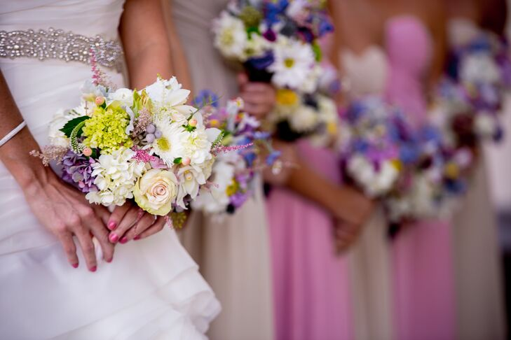 Kassandra and her bridesmaids carried small pastel bouquets with roses, hydrangeas, gerber daisies, viburnum, astilbes, silver brunia and hypericum.