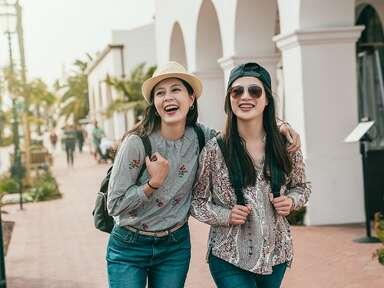two young women walking down a street in santa barabara california