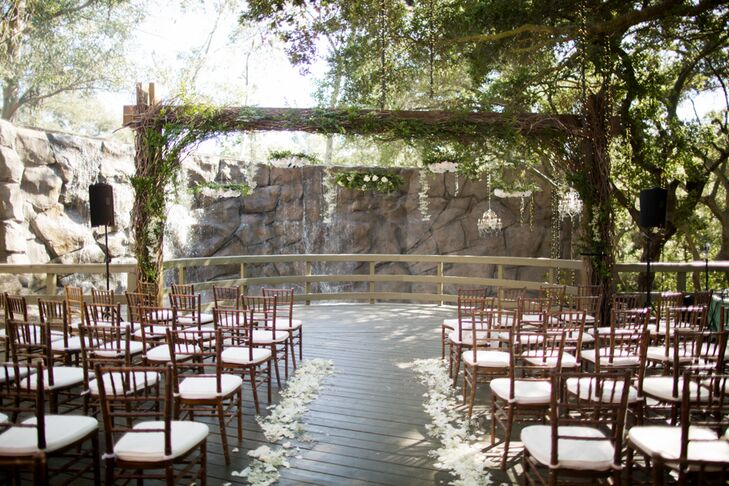 Woo Jin and Kyung exchanged vows under a large wooden arbor in front of a stone wall with a waterfall. Complementing the ceremony's lush setting were several hanging floral arrangements made with white peonies, roses and greenery such as eucalyptus.