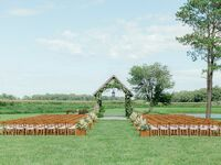 Outdoor wedding ceremony by covered bridge