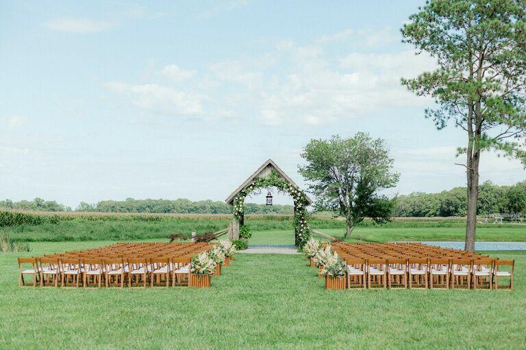 Outdoor wedding ceremony by covered bridge