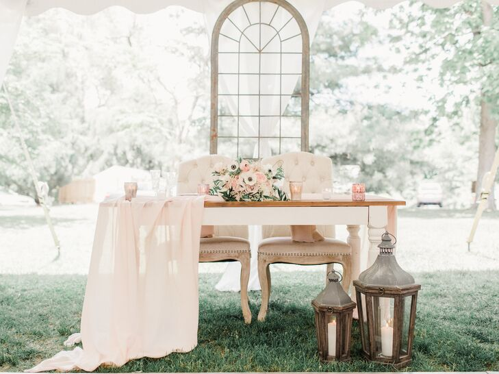 Romantic Sweetheart Table with Vintage Lantern and Backdrop