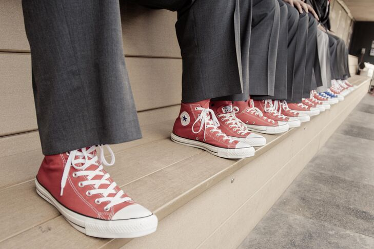 The groomsmen wore high-top red Converse shoes.