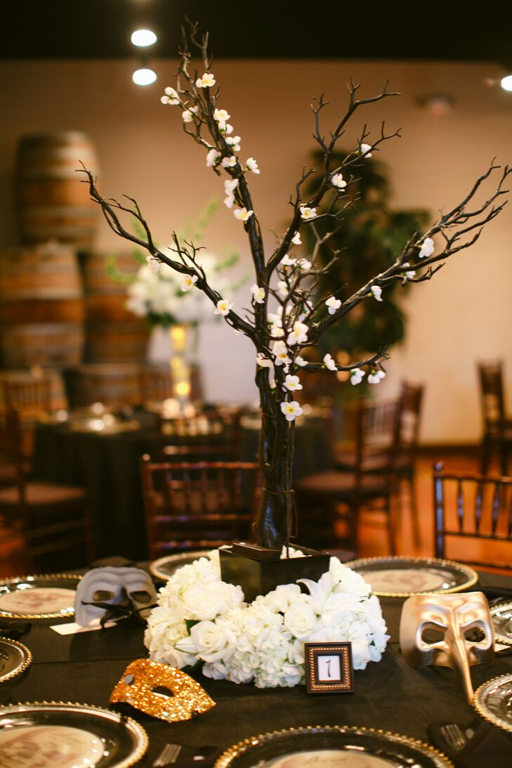 Vanessa created all of her own decor and centerpieces. She decorated manzanita trees with flower lights and made all of the masks in glitter and gold leaf for her guests to take home as favors.