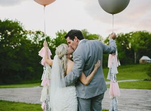 Pale shades of pink, gray, ivory and champagne gave Kayla and Tyler's barn wedding a soft, romantic vibe.