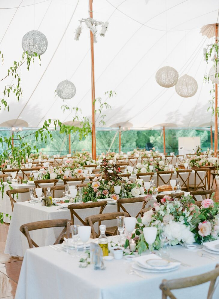 Hanging lanterns, vineyard chairs and lush tablescapes transported guests from Sarah's backyard to a dream-like dinner party.