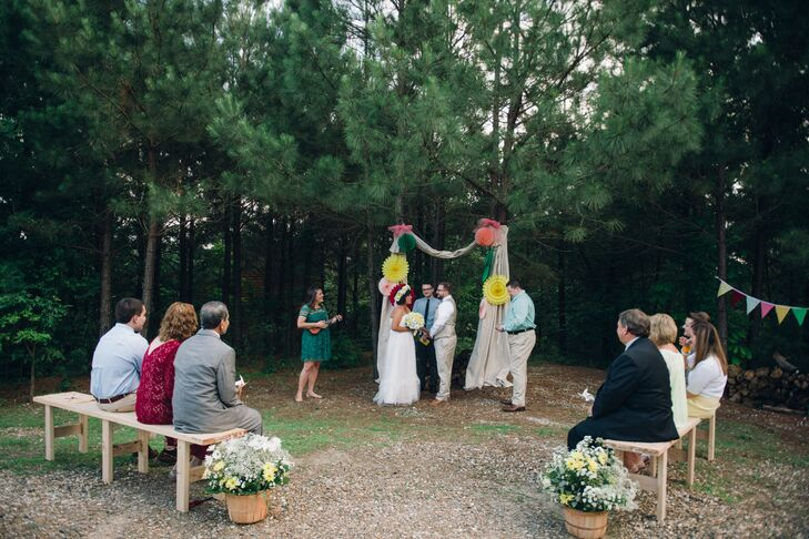 Jared's brother, Christopher, who introduced Namia and Jared, officiated their intimate outdoor wedding ceremony. The wedding arch had red, green and yellow flowers on draped neutral fabric to tie in to the color theme, and guests sat on picnic benches.