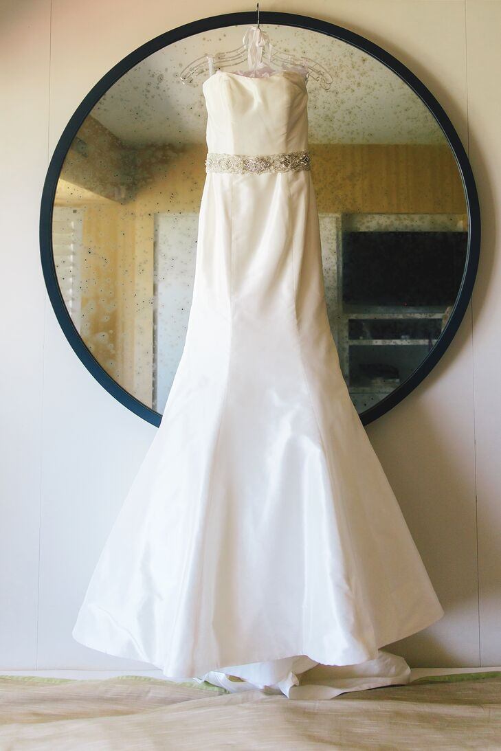"""""""Madeline wore an ivory trumpet-style tulle New York wedding gown with a large train, purchased at The White Dress in Corona Del Mar,"""" says the couple. """"She wore a hand-crafted belt around the waist, delicately embellished with small pearls, and light pink Kurt Geiger heels."""""""
