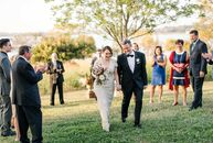 "A serene hilltop setting took center stage at the wedding of Alicia Stepp (41 and a photographer) and Allan Tait (47 and a database developer). ""Allan"