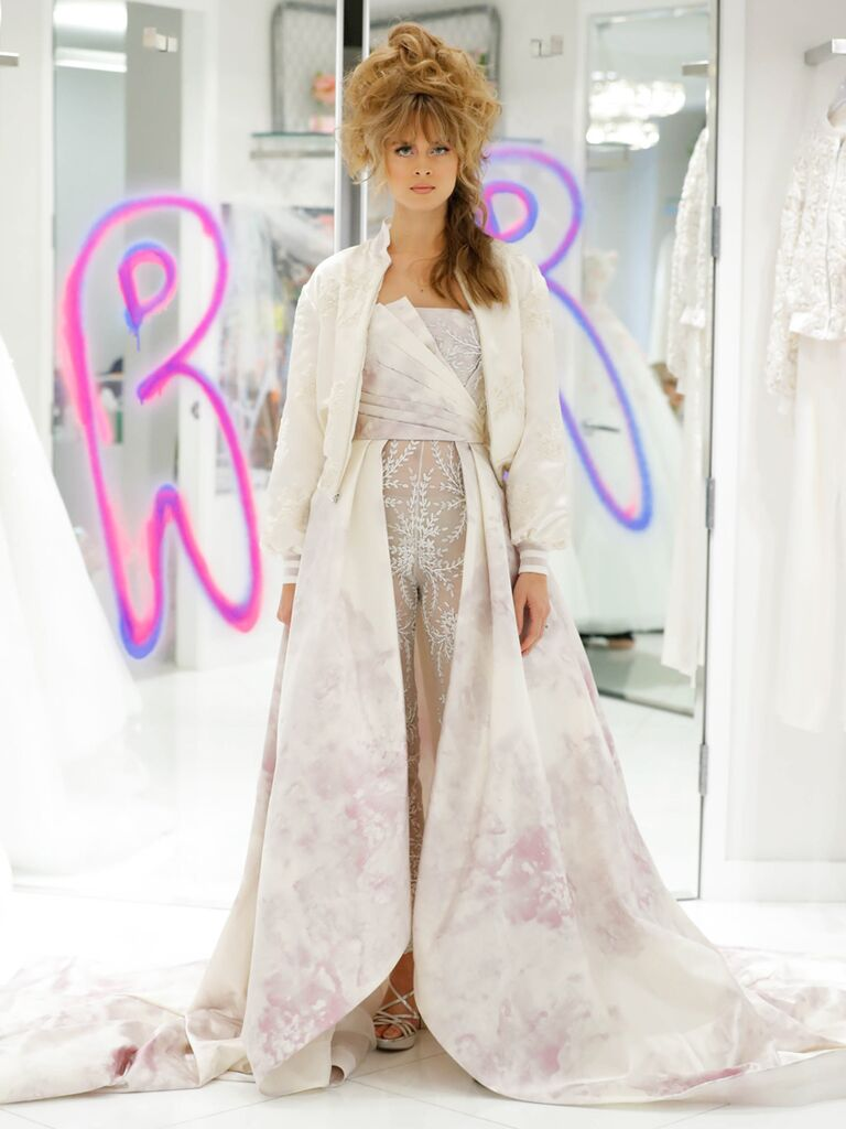 Randi Rahm Fall 2019 Bridal Fashion Week Collection asymmetrical wedding dress with pink floral designs and lace pants