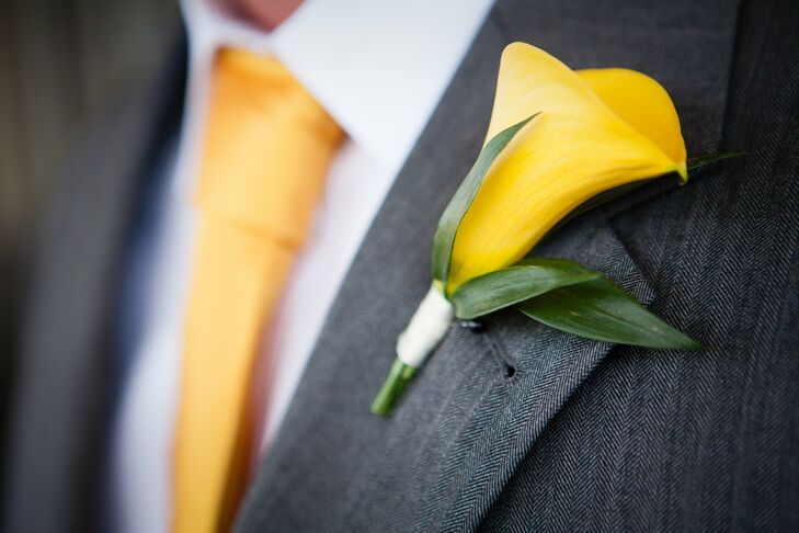 Law wore a single yellow calla lily pinned to the lapel of his gray suit.