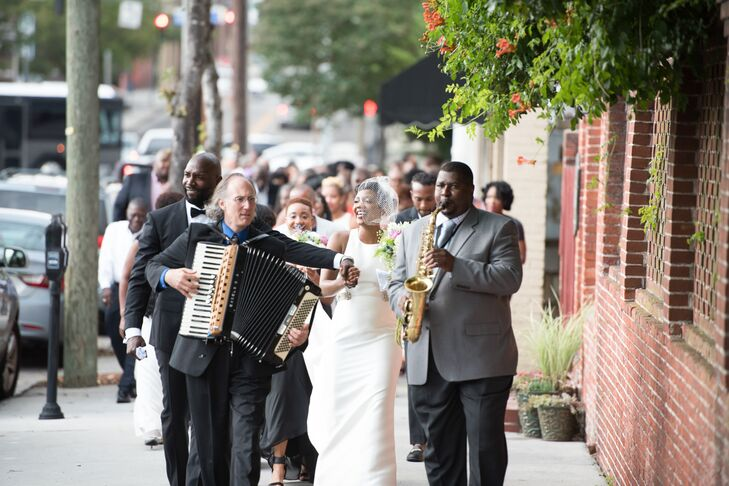 "The jazz band that played during the ceremony serenaded the couple to ""When the Saints Go Marching In"" from the ceremony site to the reception site, Bakery 105 in Wilmington, North Carolina"