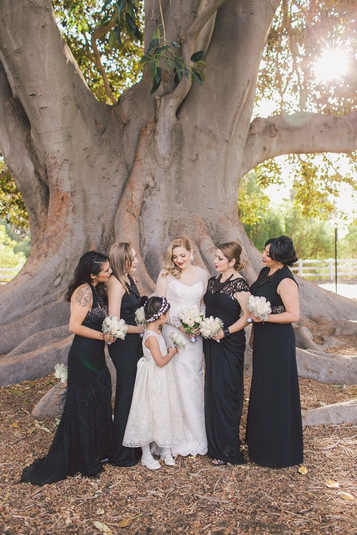 Bridesmaids wore long, floor-length black dresses, while Irene's flower girl stayed traditional in a sleeveless white dress.