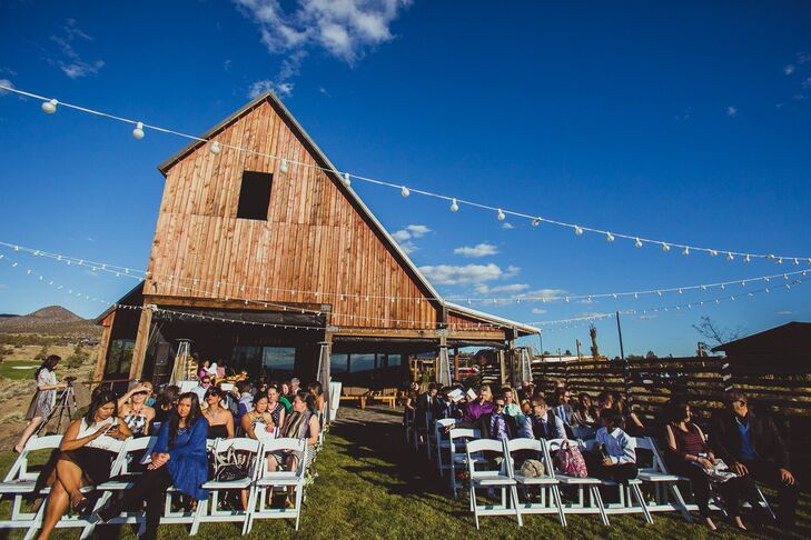 The outdoor ceremony took place outside of the rustic barn at Brasada Ranch in Powell Butte, Oregon.