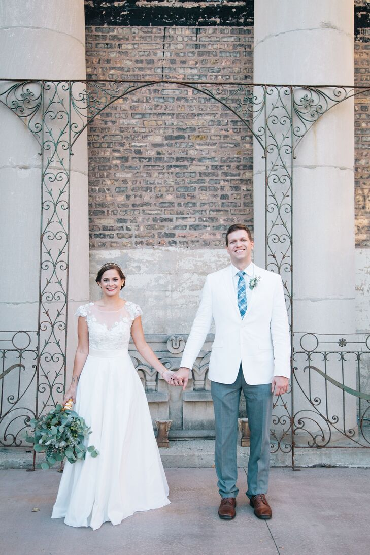 """Both the bride and groom wore white for their big day. """"Rob wearing white was a great reminder to guests that it's his day too,"""" Sarah says. """"Plus, it took some attention off of me!"""""""