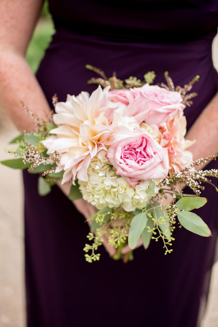The bridesmaids carried pink-and-white bouquets of garden roses and hydrangeas. The flowers were tied together with a sparkly brooch.