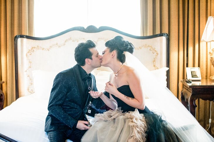 Lindsay's Vera Wang gown had layers of black and nude tulle and was topped with a black bodice. Justin and the groomsmen wore pleather-lapel suit jackets, high black ascots, black button-down vests and black skinny ties.
