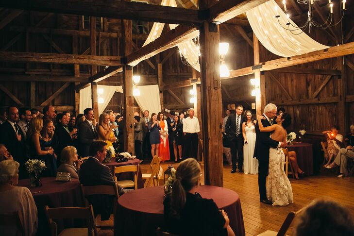 The couple shared their first dance in the elegantly decorated barn.