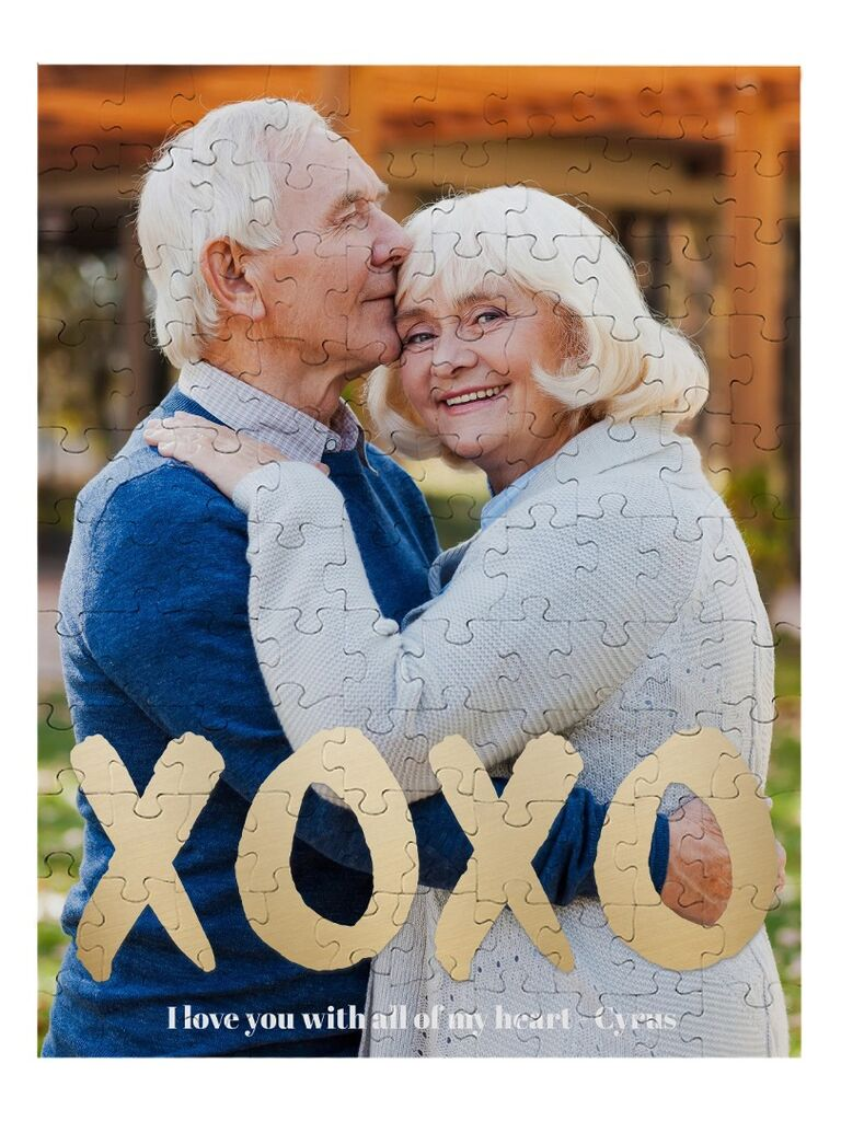 Custom photo puzzle featuring older couple and XOXO in gold lettering