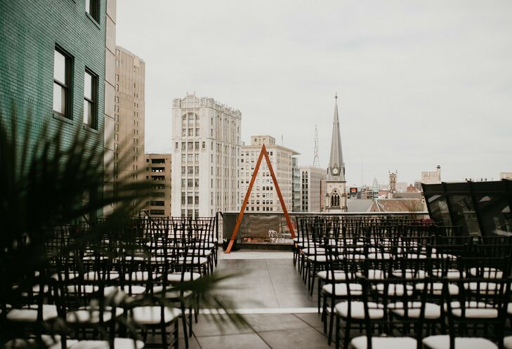 Urban Rooftop Wedding Ceremony with Arch in Detroit, Michigan