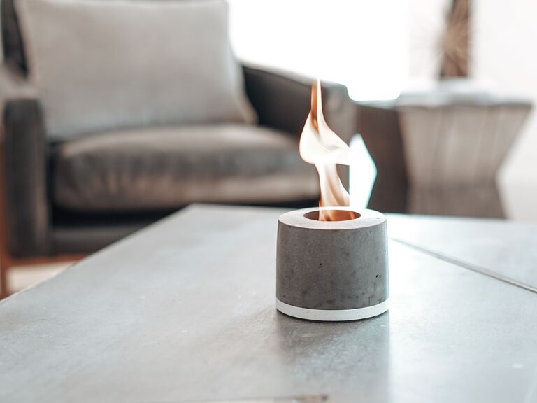 Mini concrete fire pit with flame on living room table Valentine's gift idea
