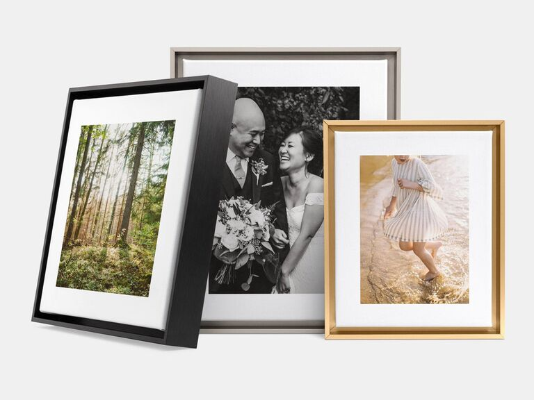 Black, silver and brass photo frames with different pictures inside