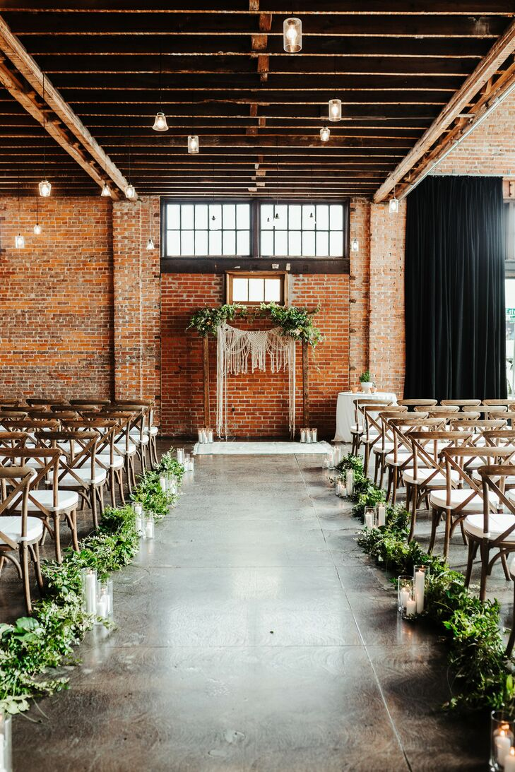 Industrial Loft Ceremony with Exposed Brick and Greenery at CAVU TPA in Tampa, Florida