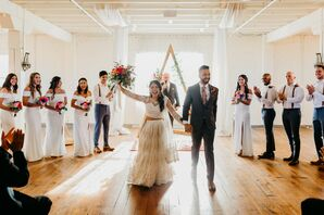 Bride and Groom Joyfully Recess From Ceremony