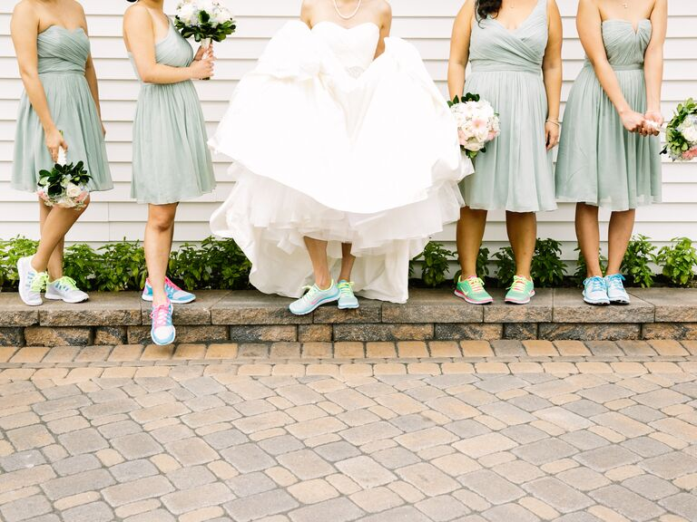 A bride and her bridesmaids wear sneakers instead of heels